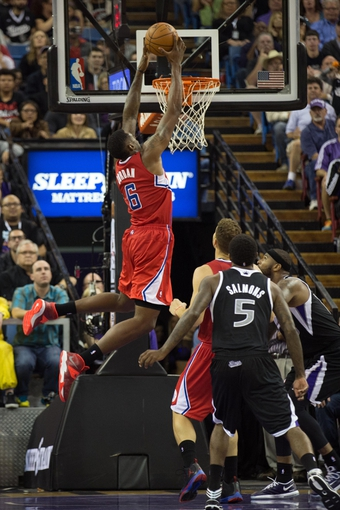 Nov 1, 2013; Sacramento, CA, USA; Los Angeles Clippers center DeAndre Jordan (6) dunks the ball against the Sacramento Kings during the fourth quarter at Sleep Train Arena. The Los Angeles Clippers defeated the Sacramento Kings 110-101. Mandatory Credit: Kelley L Cox-USA TODAY Sports