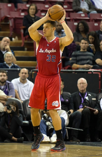 Nov 1, 2013; Sacramento, CA, USA; Los Angeles Clippers power forward Blake Griffin (32) controls the ball against the Sacramento Kings during the fourth quarter at Sleep Train Arena. The Los Angeles Clippers defeated the Sacramento Kings 110-101. Mandatory Credit: Kelley L Cox-USA TODAY Sports