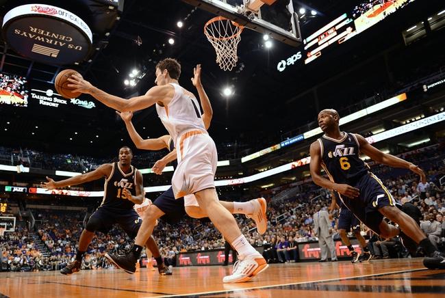 Nov 1, 2013; Phoenix, AZ, USA; Phoenix Suns guard Goran Dragic (1) makes a pass against the Utah Jazz defense forward Derrick Favors (15) and guard Jamaal Tinsley (6) in the first half at US Airways Center. The Suns defeated the Jazz 87-84.  Mandatory Credit: Jennifer Stewart-USA TODAY Sports