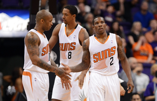 Nov 1, 2013; Phoenix, AZ, USA; Phoenix Suns guard Eric Bledsoe (2) is congratulated by forward P.J Tucker (17) on the court in the second half of the game against the Utah Jazz at US Airways Center. The Suns defeated the Jazz 87-84.  Mandatory Credit: Jennifer Stewart-USA TODAY Sports