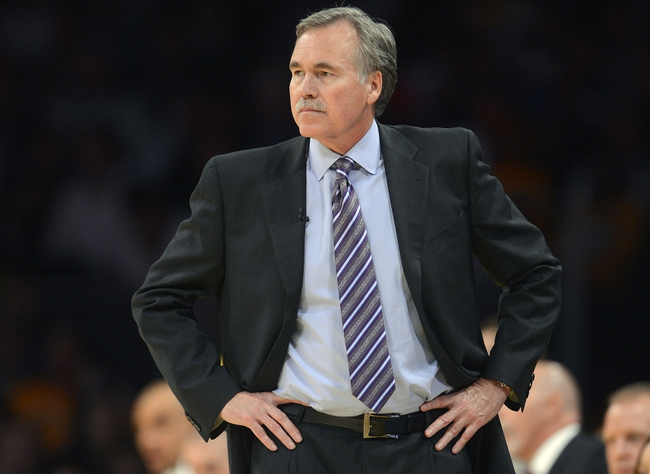 November 1, 2013; Los Angeles, CA, USA; Los Angeles Lakers head coach Mike D'Antoni watches game action against the San Antonio Spurs during the second half at Staples Center. Mandatory Credit: Gary A. Vasquez-USA TODAY Sports