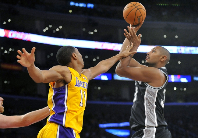November 1, 2013; Los Angeles, CA, USA; San Antonio Spurs power forward Boris Diaw (33) attempts a shot against the Los Angeles Lakers during the second half at Staples Center. Mandatory Credit: Gary A. Vasquez-USA TODAY Sports
