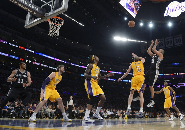 November 1, 2013; Los Angeles, CA, USA; San Antonio Spurs point guard Tony Parker (9) shoots a basket against the Los Angeles Lakers during the second half at Staples Center. Mandatory Credit: Gary A. Vasquez-USA TODAY Sports