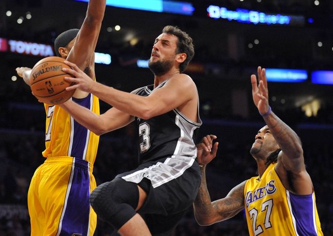 November 1, 2013; Los Angeles, CA, USA; San Antonio Spurs shooting guard Marco Belinelli (3) goes in for a basket against the Los Angeles Lakers during the second half at Staples Center. Mandatory Credit: Gary A. Vasquez-USA TODAY Sports