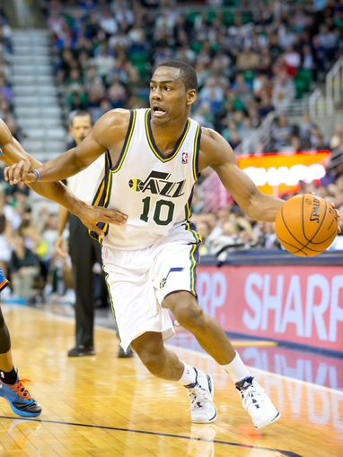 Oct 30, 2013; Salt Lake City, UT, USA; Utah Jazz point guard Alec Burks (10) dribbles the ball during the second half against the Oklahoma City Thunder at EnergySolutions Arena. Oklahoma City won 101-98. Mandatory Credit: Russ Isabella-USA TODAY Sports