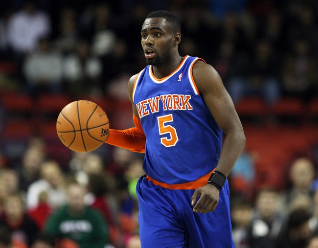 Oct 23, 2013; Green Bay, WI, USA; New York Knicks guard Tim Hardaway (5) drives the ball down the floor as his team plays the Milwaukee Bucks at the Resch Center in Green Bay. The Bucks defeated the Knicks 105-95. Mandatory Credit: Mary Langenfeld-USA TODAY Sports
