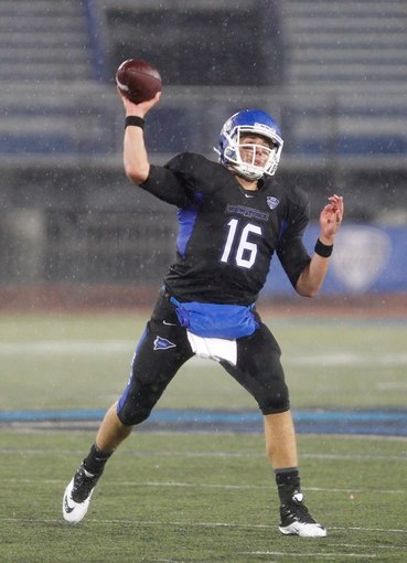 Oct 19, 2013; Buffalo, NY, USA; Buffalo Bulls quarterback Joe Licata (16) throws a pass against the Massachusetts Minutemen at University of Buffalo Stadium. Buffalo beats Massachusetts 32 to 3.  Mandatory Credit: Timothy T. Ludwig-USA TODAY Sports