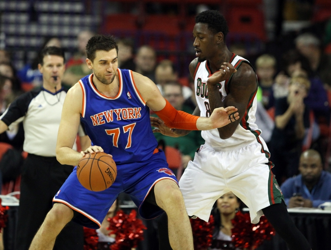 Oct 23, 2013; Green Bay, WI, USA; New York Knicks forward Andrea Bargnani (77) attempts to move the ball as Milwaukee Bucks center Larry Sanders defends at the Resch Center in Green Bay. The Bucks defeated the Knicks 105-95. Mandatory Credit: Mary Langenfeld-USA TODAY Sports