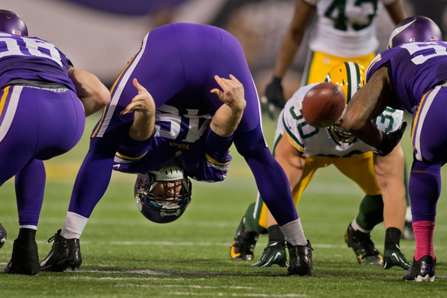 Oct 27, 2013; Minneapolis, MN, USA; Minnesota Vikings long snapper Cullen Loeffler (46) snaps the ball to the punter in the game against the Green Bay Packers in the fourth quarter at Mall of America Field at H.H.H. Metrodome. The Packers win 44-31. Mandatory Credit: Bruce Kluckhohn-USA TODAY Sports
