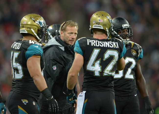 Oct 27, 2013; London, United Kingdom; Jacksonville Jaguars special teams coordinator Mike Mallory (center) talks with fullback Will Tau'ufo'ou (45) and safety Chris Posinski (42) during the NFL International Series game against the San Francsico 49ers at Wembley Stadium. The 49ers defeated the Jaguars 42-10. Mandatory Credit: Kirby Lee-USA TODAY Sports