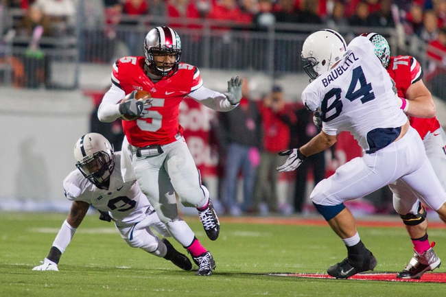 Oct 26, 2013; Columbus, OH, USA;  Penn State Nittany Lions cornerback Jordan Lucas (9) misses a tackle on Ohio State Buckeyes quarterback Braxton Miller (5) in the game at Ohio Stadium. The Ohio State Buckeyes beat the Penn State Nittany Lions 63-14. Mandatory Credit: Trevor Ruszkowksi-USA TODAY Sports