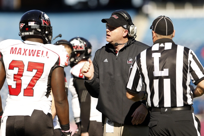 Nov 2, 2013; Foxborough, MA, USA; Northern Illinois Huskies head coach Rod Carey talks to  tight end Desroy Maxwell (37) during a break in the action as they take on Massachusetts Minutemen during the first half at Gillette Stadium. Mandatory Credit: David Butler II-USA TODAY Sports
