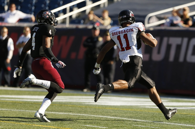 Nov 2, 2013; Foxborough, MA, USA; Northern Illinois Huskies wide receiver Juwan Brescacin (11) runs the ball for a touchdown against Massachusetts Minutemen defensive back Randall Jette (4) during the second quarter at Gillette Stadium. Mandatory Credit: David Butler II-USA TODAY Sports