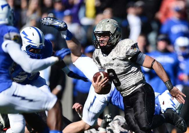Nov 2, 2013; Colorado Springs, CO, USA; Army Cadets quarterback Angel Santiago (3) carries the ball in the second quarter against the Air Force Falcons at Falcon Stadium. Mandatory Credit: Ron Chenoy-USA TODAY Sports