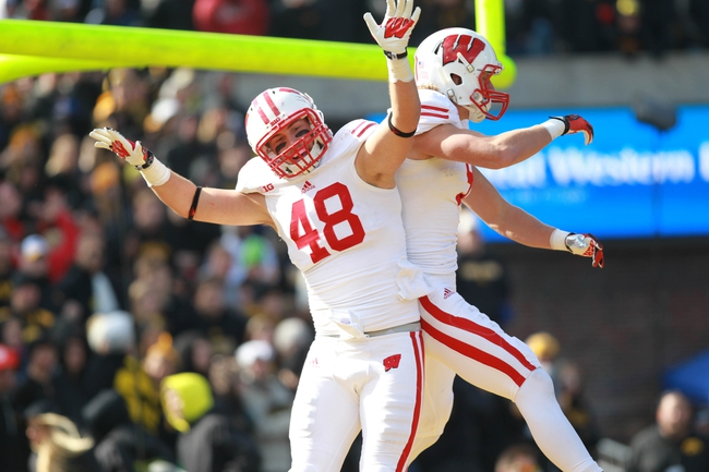 Nov 2, 2013; Iowa City, IA, USA; Wisconsin Badgers tight end Jacob Petersen (48) celebrates his touchdown against the Iowa Hawkeyes at Kinnick Stadium. Mandatory Credit: Reese Strickland-USA TODAY Sports