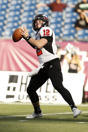Nov 2, 2013; Foxborough, MA, USA; Northern Illinois Huskies quarterback Drew Hare (12) throws a pass against the Massachusetts Minutemen during the second half at Gillette Stadium. Northern Illinois defeated Massachusetts 63-19. Mandatory Credit: David Butler II-USA TODAY Sports