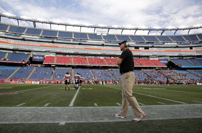 Nov 2, 2013; Foxborough, MA, USA; Northern Illinois Huskies head coach Rod Carey watches from the sideline as they take on Massachusetts Minutemen during the second half at Gillette Stadium. Northern Illinois defeated Massachusetts 63-19. Mandatory Credit: David Butler II-USA TODAY Sports