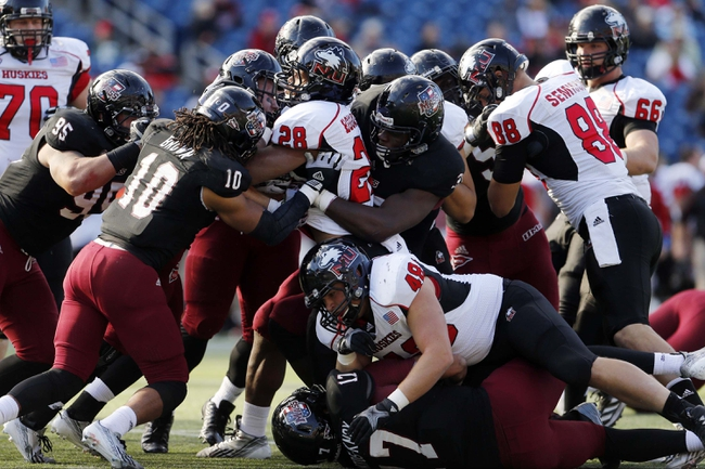 Nov 2, 2013; Foxborough, MA, USA; Northern Illinois Huskies running back Joel Bouagnon (28) is tackled by the Massachusetts Minutemen during the second half at Gillette Stadium. Northern Illinois defeated Massachusetts 63-19. Mandatory Credit: David Butler II-USA TODAY Sports
