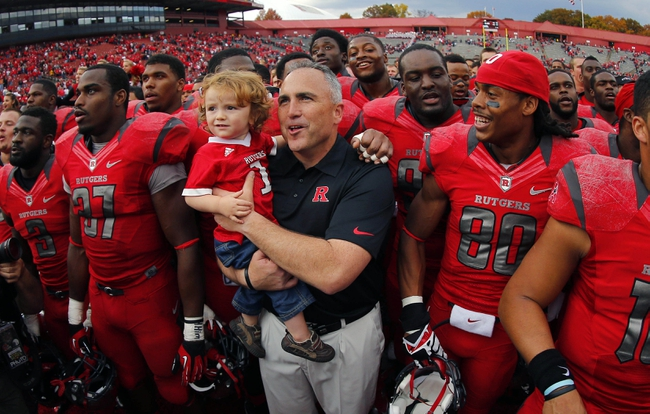 Nov 2, 2013; Piscataway, NJ, USA;  Rutgers Scarlet Knights head coach Kyle Flood celebrates with son Joseph Flood and his team after a come from behind victory over the Temple Owls at High Points Solutions Stadium. Rutgers Scarlet Knights defeat the Temple Owls 23-20. Mandatory Credit: Jim O'Connor-USA TODAY Sports