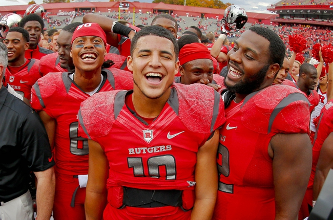 Nov 2, 2013; Piscataway, NJ, USA;  Rutgers Scarlet Knights quarterback Gary Nova (10) celebrates a come from behind victory with teammates wide receiver Ruhann Peele (left) and defensive lineman Isaac Holmes (72) at High Points Solutions Stadium. Rutgers Scarlet Knights defeat the Temple Owls 23-20. Mandatory Credit: Jim O'Connor-USA TODAY Sports