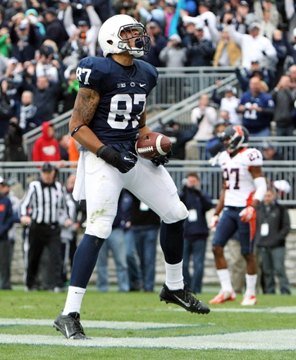 Nov 2, 2013; University Park, PA, USA; Penn State Nittany Lions tight end Kyle Carter (87) celebrates after scoring a touchdown during overtime against the Illinois Fighting Illini at Beaver Stadium. Mandatory Credit: Matthew O'Haren-USA TODAY Sports