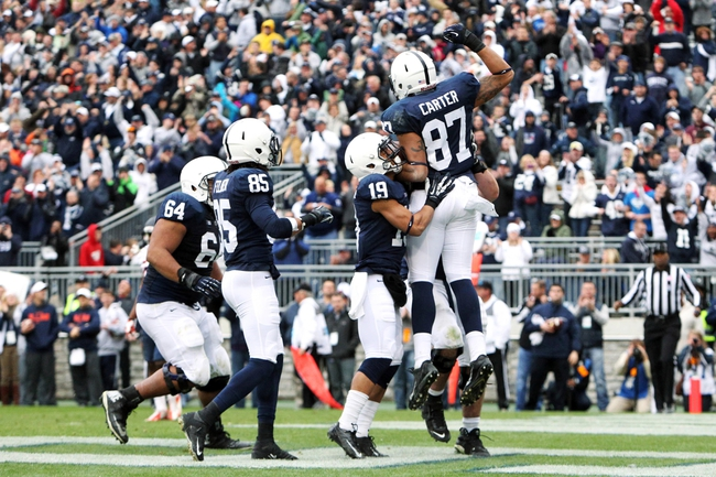 Nov 2, 2013; University Park, PA, USA; Penn State Nittany Lions tight end Kyle Carter (87) celebrates with teammates after scoring a touchdown during overtime against the Illinois Fighting Illini at Beaver Stadium. Mandatory Credit: Matthew O'Haren-USA TODAY Sports