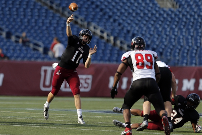 Nov 2, 2013; Foxborough, MA, USA; Massachusetts Minutemen quarterback Mike Wegzyn (11) throws a pass against the Northern Illinois Huskies during the second half at Gillette Stadium. Northern Illinois defeated Massachusetts 63-19. Mandatory Credit: David Butler II-USA TODAY Sports