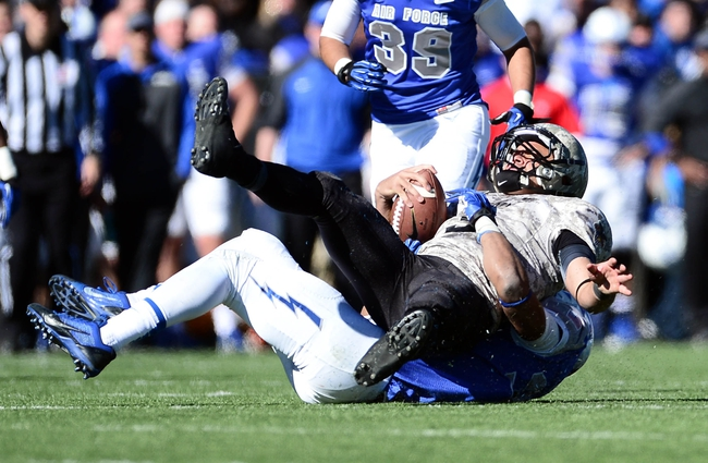 Nov 2, 2013; Colorado Springs, CO, USA; Army Black Knights quarterback Angel Santiago (3) is sacked by Air Force Falcons offensive linesman Robert Green (79) in the fourth quarter at Falcon Stadium. The Falcons defeated the Black Knights 42-28. Mandatory Credit: Ron Chenoy-USA TODAY Sports
