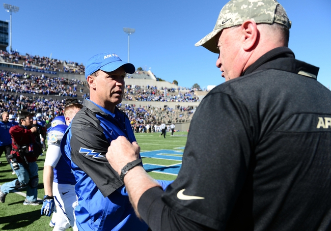 Nov 2, 2013; Colorado Springs, CO, USA; Air Force Falcons head coach Troy Calhoun greets Army Black Knights head coach Rich Ellerson following the game at Falcon Stadium. The Falcons defeated the Black Knights 42-28. Mandatory Credit: Ron Chenoy-USA TODAY Sports