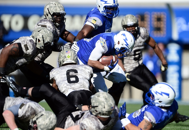 Nov 2, 2013; Colorado Springs, CO, USA; Air Force Falcons running back Devin Rushing (31) rushes in the third quarter against the Army Black Knights at Falcon Stadium. Mandatory Credit: Ron Chenoy-USA TODAY Sports