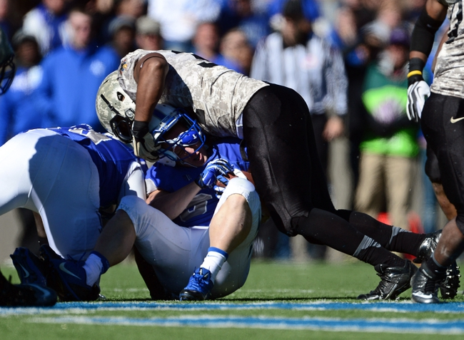 Nov 2, 2013; Colorado Springs, CO, USA; Army Black Knights defensive end Jarrett Mackey (34) stops the advance of Air Force Falcons running back Anthony LaCoste (37) in the third quarter at Falcon Stadium. The Falcons defeated the Black Knights 42-28. Mandatory Credit: Ron Chenoy-USA TODAY Sports