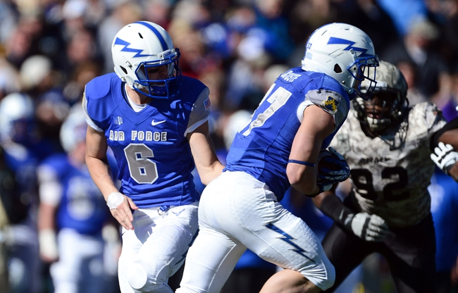 Nov 2, 2013; Colorado Springs, CO, USA; Air Force Falcons quarterback Nate Romine (6) hands off to running back Anthony LaCoste (37) in the third quarter against the Army Black Knights at Falcon Stadium. The Falcons defeated the Black Knights 42-28. Mandatory Credit: Ron Chenoy-USA TODAY Sports