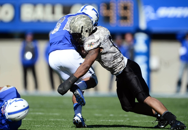 Nov 2, 2013; Colorado Springs, CO, USA; Air Force Falcons running back Devin Rushing (31) is tackled by Army Black Knights linebacker Geoffery Bacon (6) in the third quarter at Falcon Stadium.The Falcons defeated the Black Knights 42-28. Mandatory Credit: Ron Chenoy-USA TODAY Sports