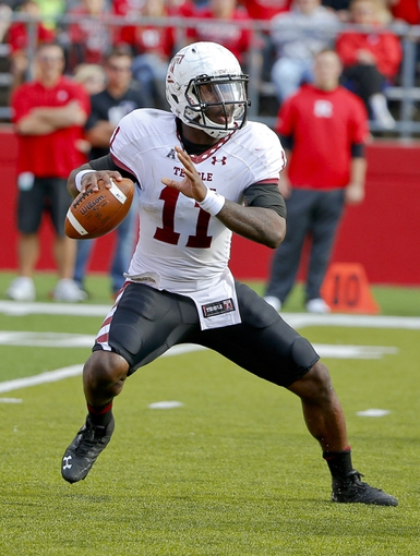 Nov 2, 2013; Piscataway, NJ, USA;  Temple Owls quarterback P.J. Walker (11) during the second half against the Rutgers Scarlet Knights at High Points Solutions Stadium. Rutgers Scarlet Knights defeat the Temple Owls 23-20. Mandatory Credit: Jim O'Connor-USA TODAY Sports