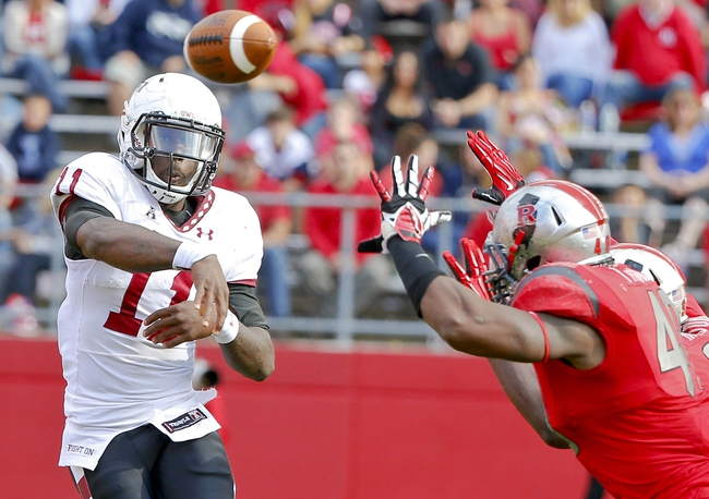 Nov 2, 2013; Piscataway, NJ, USA;  Temple Owls quarterback P.J. Walker (11) throws against the Rutgers Scarlet Knights during the second half at High Points Solutions Stadium. Rutgers Scarlet Knights defeat the Temple Owls 23-20. Mandatory Credit: Jim O'Connor-USA TODAY Sports