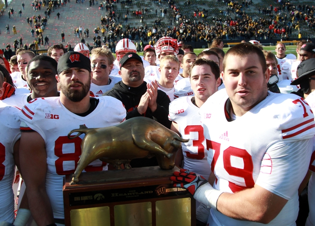 Nov 2, 2013; Iowa City, IA, USA; The Wisconsin Badgers sing their fight song and share the Heartland Trophy with fans after their win against the Iowa Hawkeyes at Kinnick Stadium.  Wisconsin beat Iowa 28-9.  Mandatory Credit: Reese Strickland-USA TODAY Sports