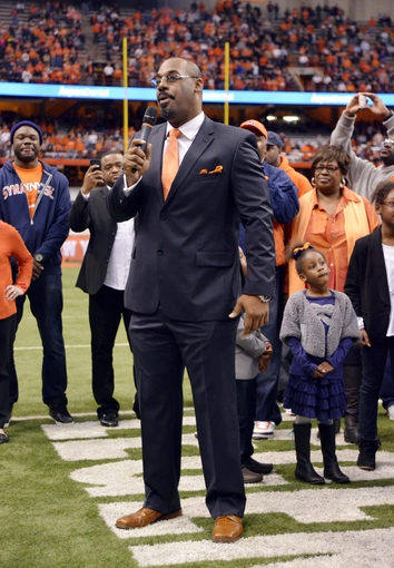Nov 2, 2013; Syracuse, NY, USA;  Syracuse Orange former quarterback Donovan McNabb speaks to the crowd after having his jersey retired during halftime of a game against the Wake Forest Demon Deacons at the Carrier Dome. Mandatory Credit: Mark Konezny-USA TODAY Sports