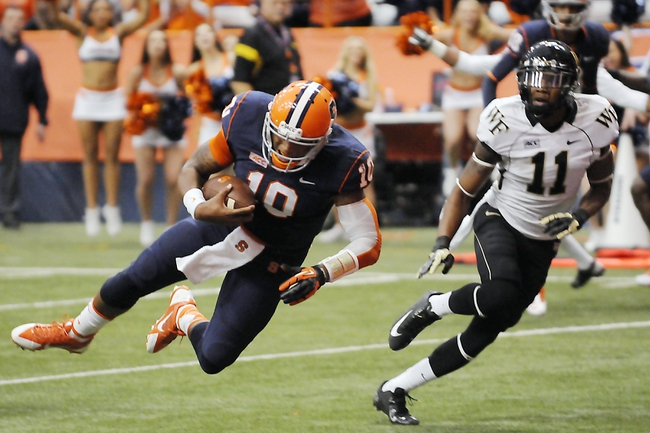 Nov 2, 2013; Syracuse, NY, USA; Syracuse Orange quarterback Terrel Hunt (10) scores a touchdown in the third quarter of a game against the Wake Forest Demon Deacons at the Carrier Dome. Mandatory Credit: Mark Konezny-USA TODAY Sports