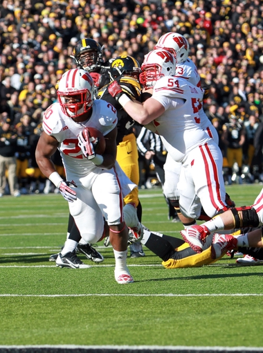 Nov 2, 2013; Iowa City, IA, USA;  Wisconsin Badgers running back James White (20) runs for the touchdown against the Iowa Hawkeyes at Kinnick Stadium.  Wisconsin beat Iowa 28-9.  Mandatory Credit: Reese Strickland-USA TODAY Sports