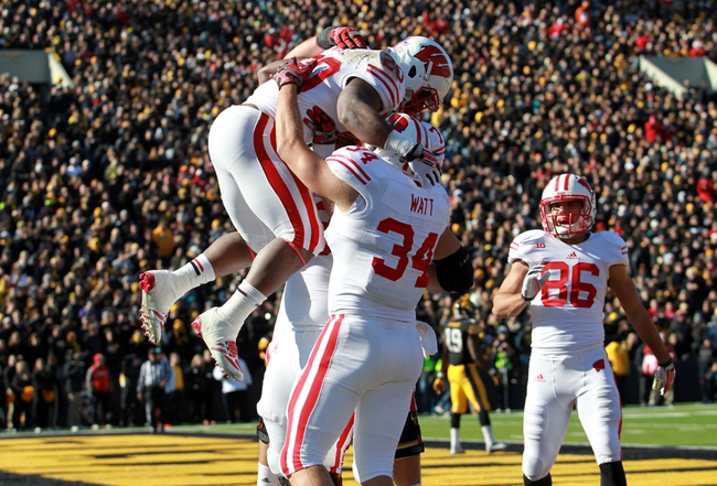 Nov 2, 2013; Iowa City, IA, USA;  Wisconsin Badgers running back James White (20) celebrates with teammates Derek Watt (34) and Dan Voltz (70) in the endzone after scoring a touchdown against the Iowa Hawkeyes at Kinnick Stadium.  Wisconsin beat Iowa 28-9.  Mandatory Credit: Reese Strickland-USA TODAY Sports