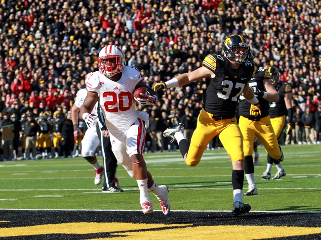 Nov 2, 2013; Iowa City, IA, USA;  Wisconsin Badgers running back James White (20) is chased into the endzone by Iowa Hawkeyes safety John Lowdermilk (37) at Kinnick Stadium.  Wisconsin beat Iowa 28-9.  Mandatory Credit: Reese Strickland-USA TODAY Sports