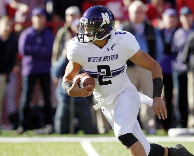 Nov 2, 2013; Lincoln, NE, USA; Northwestern Wildcats quarterback Kain Colter (2) runs against the Nebraska Cornhuskers at Memorial Stadium. Mandatory Credit: Bruce Thorson-USA TODAY Sports