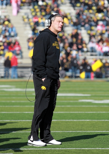 Nov 2, 2013; Iowa City, IA, USA;   Iowa Hawkeyes Head Coach Kirk Ferentz looks at the replay board in the fourth quarter against the Wisonsin Badgers at Kinnick Stadium.  Wisconsin beat Iowa 28-9.  Mandatory Credit: Reese Strickland-USA TODAY Sports
