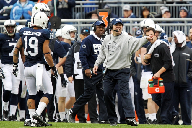 Nov 2, 2013; University Park, PA, USA; Penn State Nittany Lions head coach Bill O'Brien signals for a challenge during the fourth quarter against the Illinois Fighting Illini at Beaver Stadium. Penn State defeated Illinois 24-17. Mandatory Credit: Matthew O'Haren-USA TODAY Sports