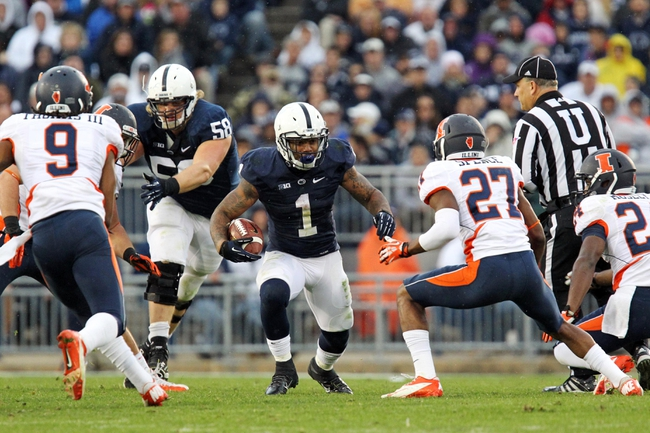 Nov 2, 2013; University Park, PA, USA; Penn State Nittany Lions running back Bill Belton (1) runs the ball during the fourth quarter against the Illinois Fighting Illini at Beaver Stadium. Penn State defeated Illinois 24-17. Mandatory Credit: Matthew O'Haren-USA TODAY Sports