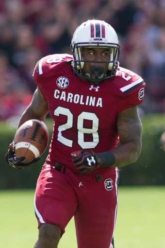Nov 2, 2013; Columbia, SC, USA; South Carolina Gamecocks running back Mike Davis (28) runs the ball during the first half against the Mississippi State Bulldogs at Williams-Brice Stadium. The Gamecocks defeated the Bulldogs 34-16.  Mandatory Credit: Jeremy Brevard-USA TODAY Sports