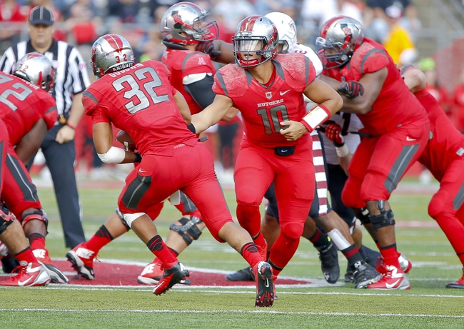 Nov 2, 2013; Piscataway, NJ, USA;  Rutgers Scarlet Knights quarterback Gary Nova (10) hands off to running back Justin Goodwin (32) during the second half against the Temple Owls at High Points Solutions Stadium. Rutgers won 23-20. Mandatory Credit: Jim O'Connor-USA TODAY Sports