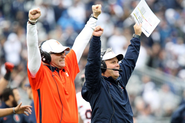 Nov 2, 2013; University Park, PA, USA; Illinois Fighting Illini head coach Tim Beckman (right) reacts during the fourth quarter against the Penn State Nittany Lions at Beaver Stadium. Penn State defeated Illinois 24-17. Mandatory Credit: Matthew O'Haren-USA TODAY Sports