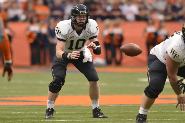 Nov 2, 2013; Syracuse, NY, USA; Wake Forest Demon Deacons quarterback Tanner Price (10) receives a shotgun snap during the second quarter of a game against the Syracuse Orange at the Carrier Dome. Mandatory Credit: Syracuse won the game 13-0. Mark Konezny-USA TODAY Sports