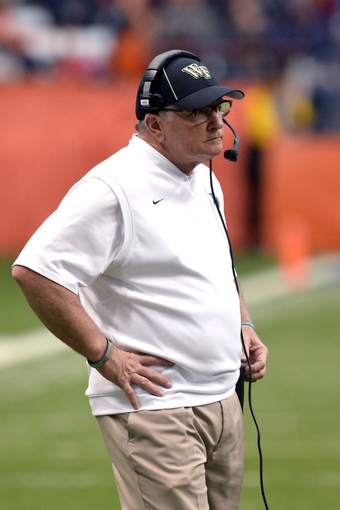 Nov 2, 2013; Syracuse, NY, USA; Wake Forest Demon Deacons head coach Jim Grobe watches his team during the second quarter of a game at the Carrier Dome. Mandatory Credit: Syracuse won the game 13-0. Mark Konezny-USA TODAY Sports